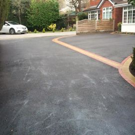 black driveway with car