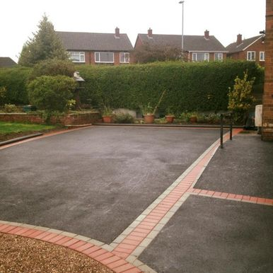 black tarmac drive and paving stones